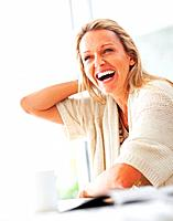 Portrait of a happy cheerful mature female laughing
