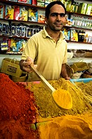 spice trader at his shop at the spice market, Tunisia, Djerba