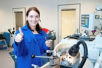 young woman works on an engine lathe