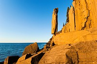 The Balancing Rock of Long Island, Nova Scotia, Canada near the Bay of Fundy is made of Jurassic basalt lava that cooled to form this vertical polygon...
