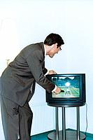 Businessman Watching Tennis on Tv
