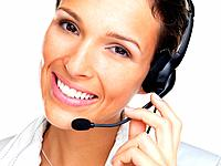 Closeup portrait of a beautiful young woman working at a helpdesk wearing headset