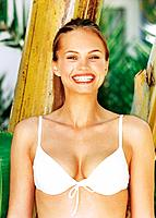Laughing young woman wearing white bikini