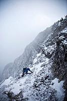 A man alpine climbing _ Coire Dubh Integrale 5.7, WI3, Canmore, Alberta, Canada