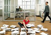 Young Woman Sorting Documents in Office