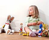 Girl Sitting with Easter Bunnies
