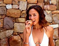 Young Woman Biting into Apple