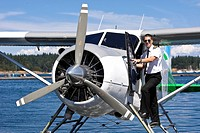 A pilot with his Beaver aircraft, about to takeoff out of Nanaimo´s inner harbour on a scheduled flight with Harbour Air. Nanaimo, Central Vancouver I...