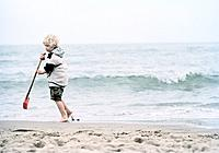 Blond Boy with Spade on the Beach