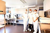 Three medical scientist standing in scientific research center