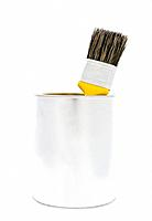 Paint can with yellow brush