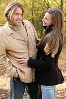 young couple flirting on an autumn walk