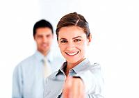Portrait of beautiful business woman pointing at you with colleague in background