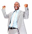 Happy African American male executive celebrating success with clenched fists over white background