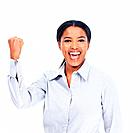 Portrait of confident African American business woman celebrating success with clenched fist over white background