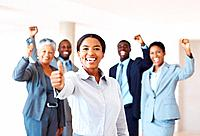 Portrait of successful mixed race female leader celebrating victory with business team