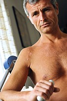 elderly man at physiotherapie caused by a surgery at the shoulder