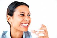 Closeup of cheerful female executive drinking water on white background