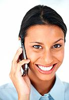 Closeup portrait of attractive female executive smiling while talking on mobile phone