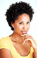 Closeup portrait of lovely African American woman smiling over white background