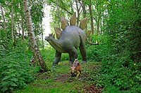 Stegosaurus Stegosaurus, with juvenile in a forest