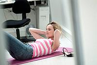 Young Woman Exercising in Office