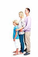 Full length of happy young family standing together in line over white background