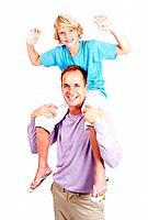 Portrait of a cute young boy sitting on his fathers shoulder and having fun against white background