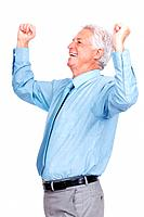 Portrait of an excited old business man standing with his arms raised standing against isolated white background