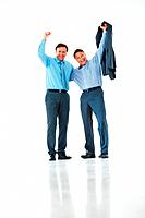 Full length of mature executives celebrating success with arms around