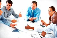 Group of executives having conversation during meeting