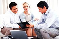 Couple discussing investment plans with business consultant