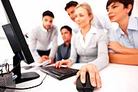 Focus on business womans hand using computer mouse during meeting