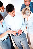High angle view of business people sharing information on cell phone