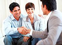 Business couple with the man shaking hands with consultant