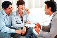Business couple discussing with professional financial consultant during meeting