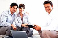 Beautiful business couple with financial consultant holding signing contract