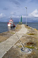 Moored fishing boat at a small pier on Achill Island, County Mayo, Ireland
