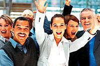 Closeup of group of executives throwing arms up in excitement