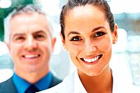 Focus on woman smiling with colleague behind her
