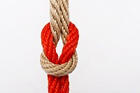 knots of orange and natural colored rope
