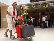 senior couple in arrivals hall