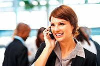 Female executive on phone call indoors