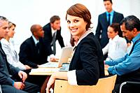 Portrait of young business woman smiling during meeting