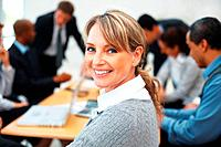 Successful female executive smiling during meeting