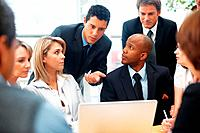 Executive explaining while colleagues listen during meeting