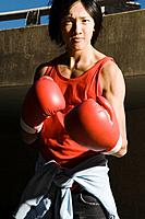 Young Man Wearing Red Boxing Gloves