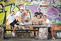 Group of Young Men by Graffiti Wall