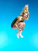 Jumping Blond Woman in Mid_air