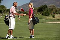 Two Golfers Shaking Hands